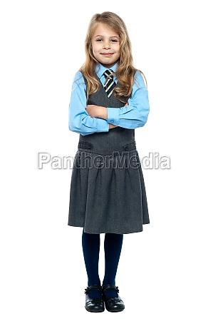 confident school girl in pinafore uniform