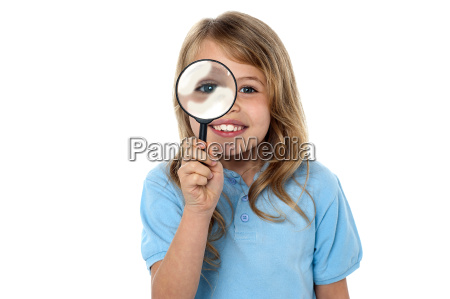 smiling kid with magnifying glass