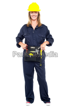 beautiful construction worker with tool belt