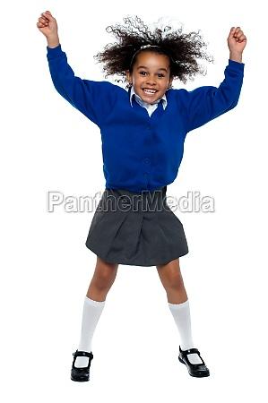pretty african school girl dances in