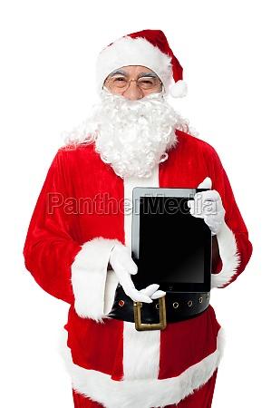 old man in santa costume posing