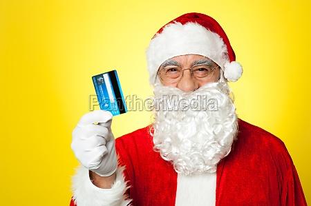 aged man in santa clothing ready