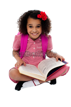 smiling pretty school girl reading a