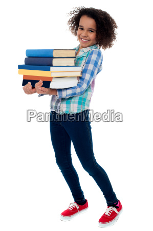 active young school kid carrying books