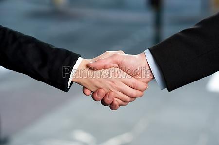 business handshake deal finalized