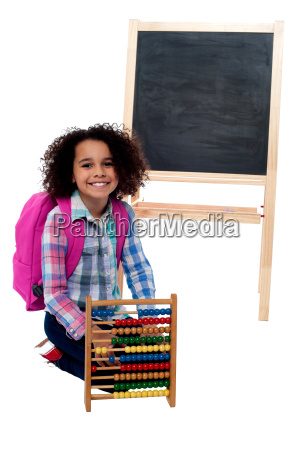 happy school girl with abacus and