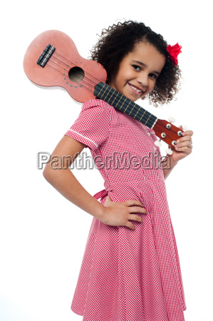 atttactive school girl with toy guitar