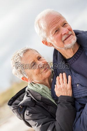 senior adult happy couple is walking