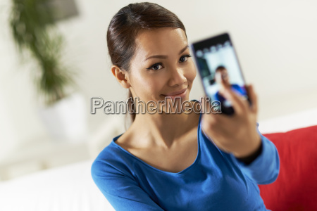 asian girl sharing pictureon social network