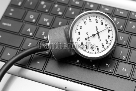 sphygmomanometer on laptop keyboard