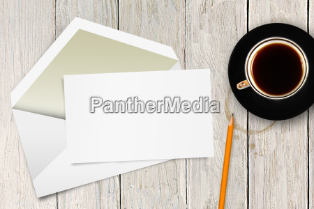 blank letter with envelope and coffee