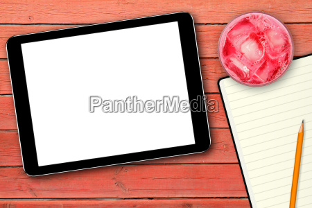 blank digital tablet on red wooden