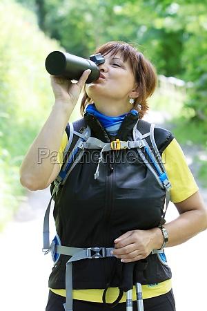 wanderin drinking from a water bottle