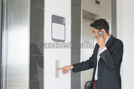indian businessman entering elevator