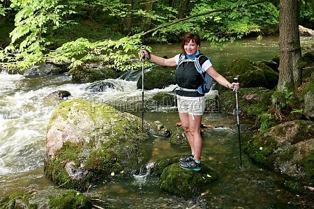 hiker at a rushing river