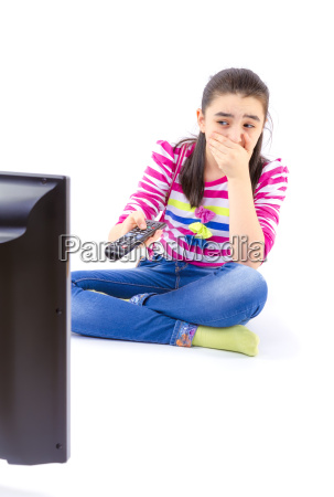 scared little girl watching tv