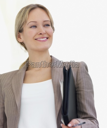 young beautiful business woman smiling holding