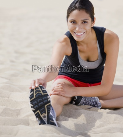 young happy female runner exercising on