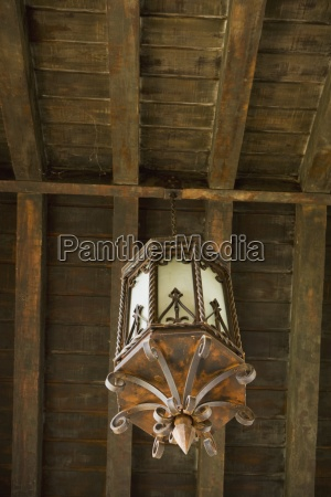 old wrought iron landern style chandelier