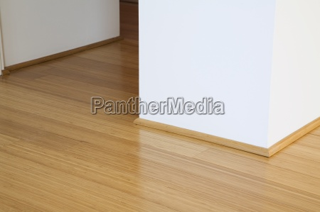 hardwood floor and white wall in