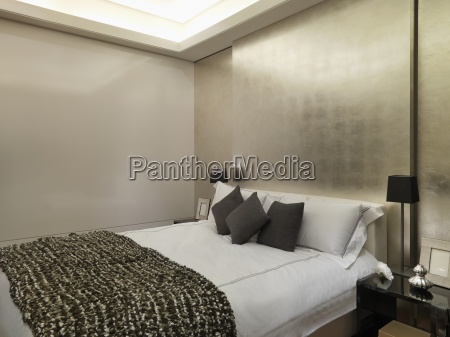 modern bedroom with gold wall