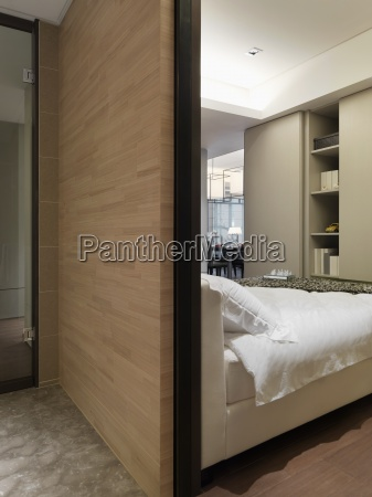 wooden wall behind bed