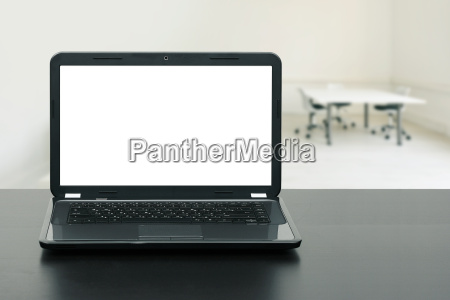 laptop with blank screen on wooden