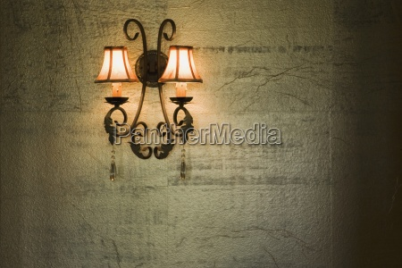wrought iron lamp on gold textured