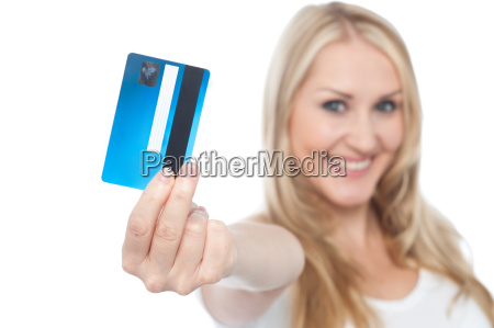 young woman showing credit card to