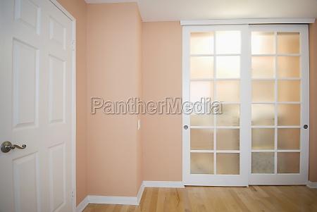sliding closet doors in peach colored