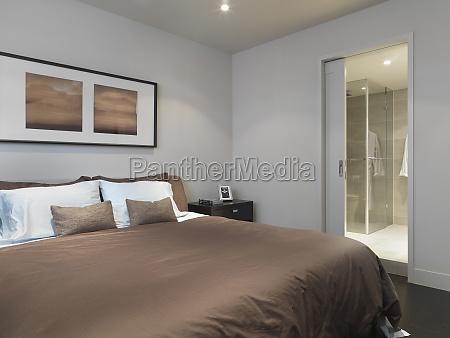 brown bed in minimalitic bedroom