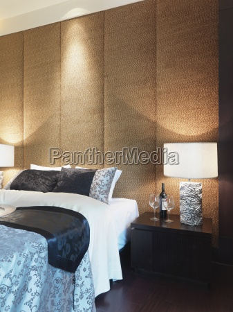 textured wall behind bed
