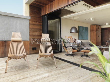 wooden chairs on deck outside modern