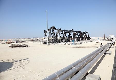 black oil pump jacks in the