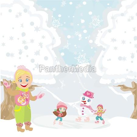 maedchen und schneemann spielen an einem