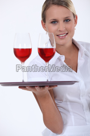 sommelier with two glasses of red