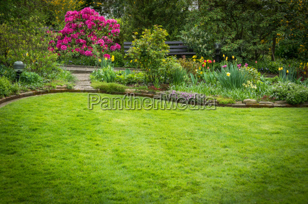 beautifully landscaped garden with lawn