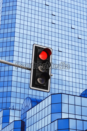 traffic lights over modern business architecture