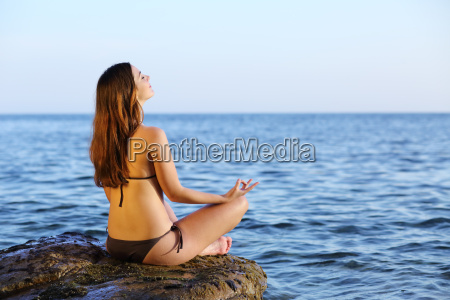 woman doing yoga exercises on the