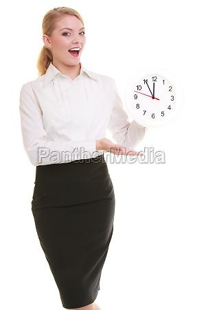portrait of a businesswoman showing clock