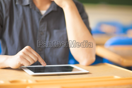 young man using a tablet or