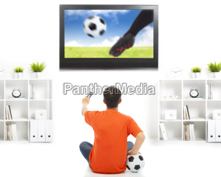 young fan watching soccer game at