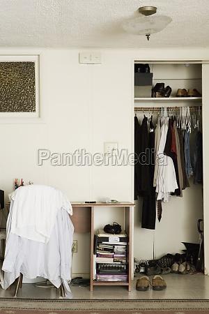 a desk and closet of a