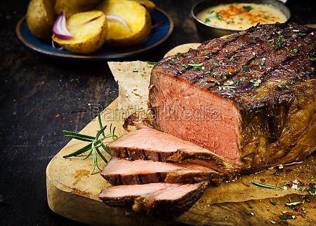 carved rare roast beef seasoned with