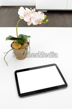 blank tablet on white table in