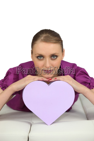 young woman lying with heart shaped