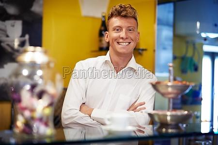 happy man working as barman smiling
