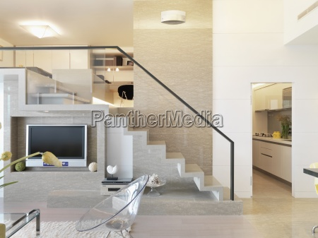 staircase and entertainment center in modern