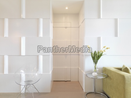 modern interior with door camouflaged with