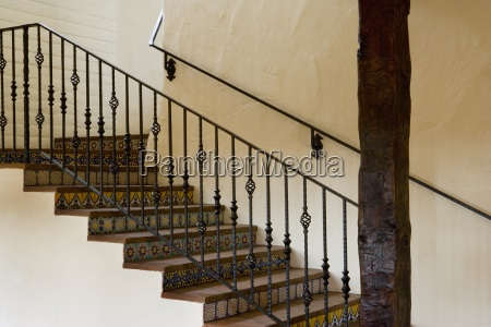 spanish style stairway with wrought iron